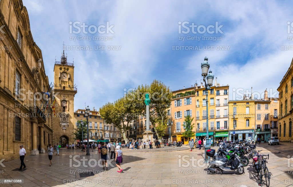 people visit the central market place with the famous hotel de ville in Aix en Provence stock photo