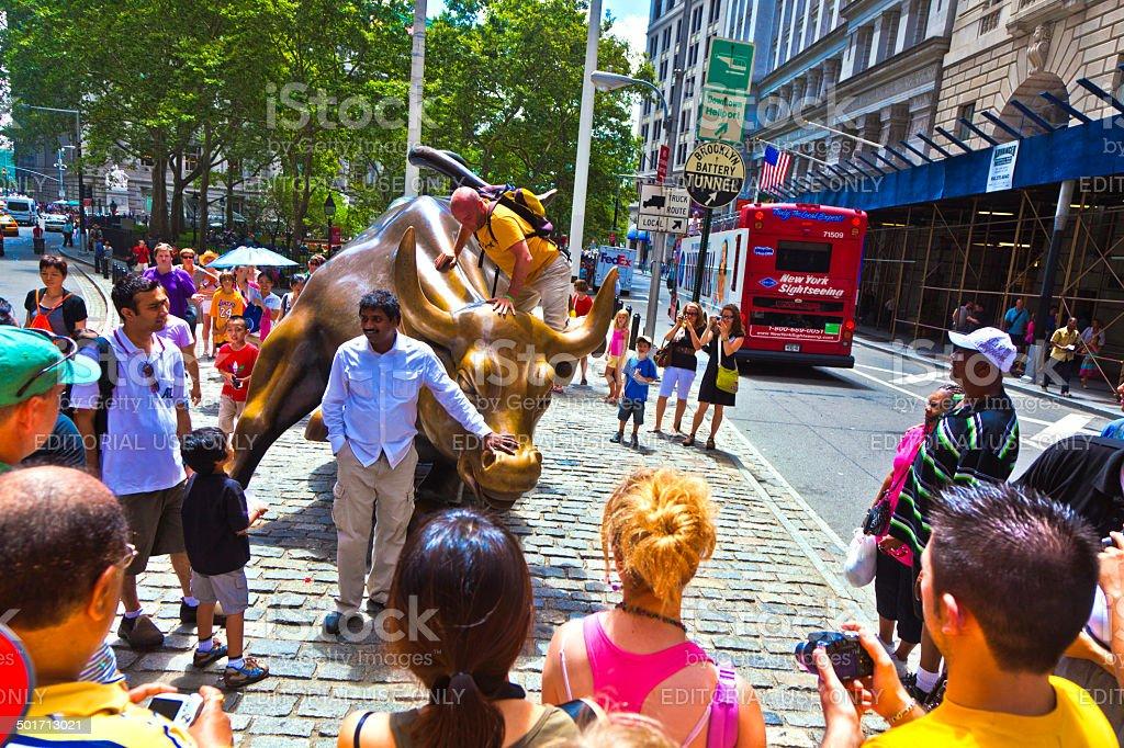 people visit the landmark Charging Bull in Lower Manhattan royalty-free stock photo