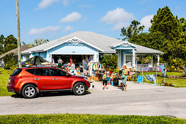 People visiting a yard sale in Port Charlotte Florida stock photo