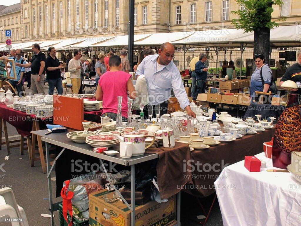 people visiting big Flea Market in the Tiergarten Berlin . In front a...