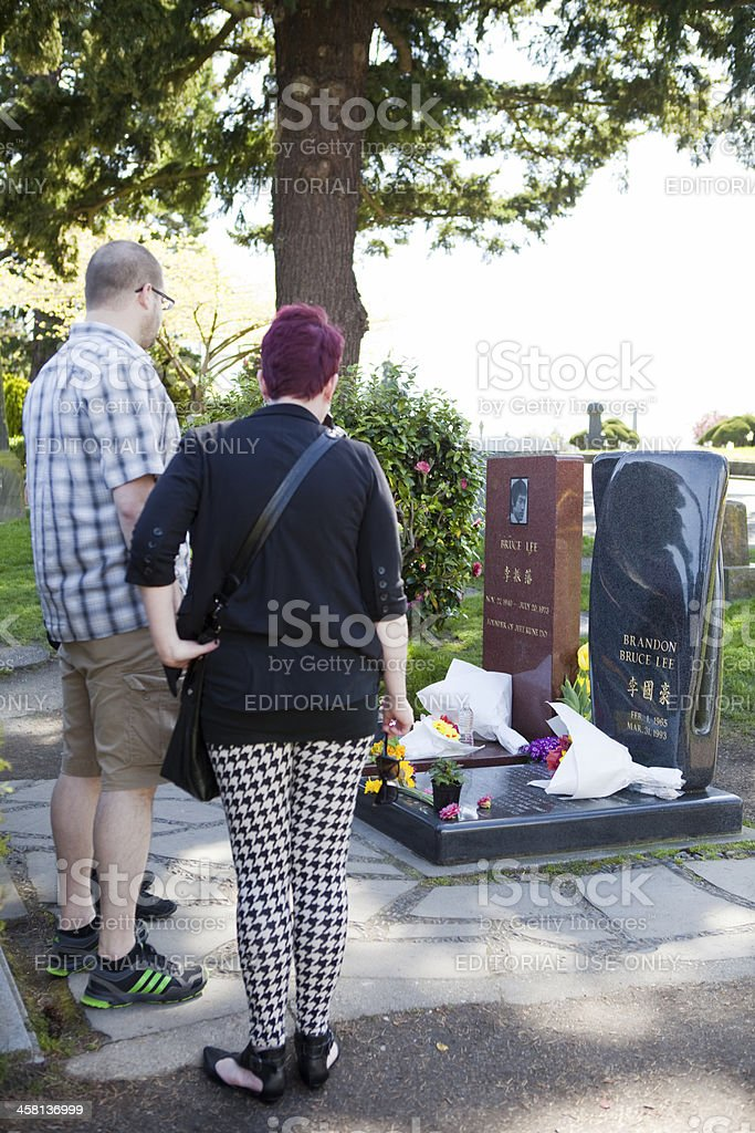 People Visiting Bruce and Brandon Lee's Grave stock photo