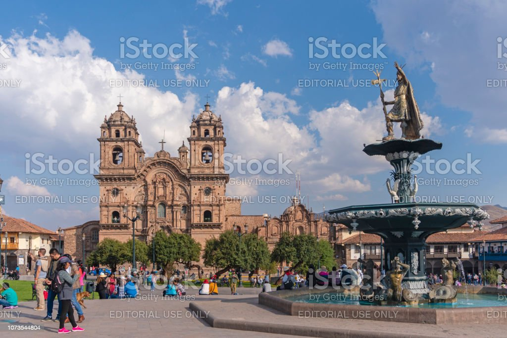 People visiting Plaza de Armas in Cusco stock photo