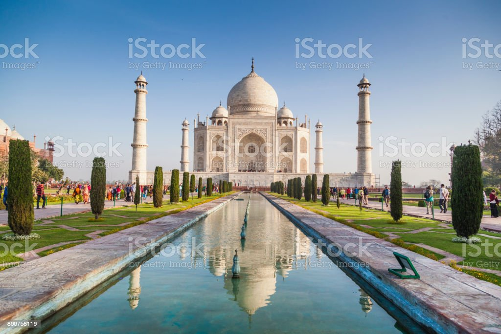 People visiting the magnificent Taj Mahal in Agra. stock photo