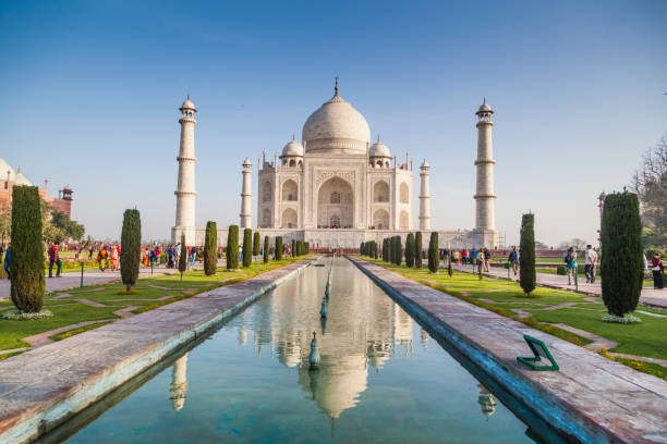 people visiting the magnificent taj mahal in agra. - international landmark stock photos and pictures