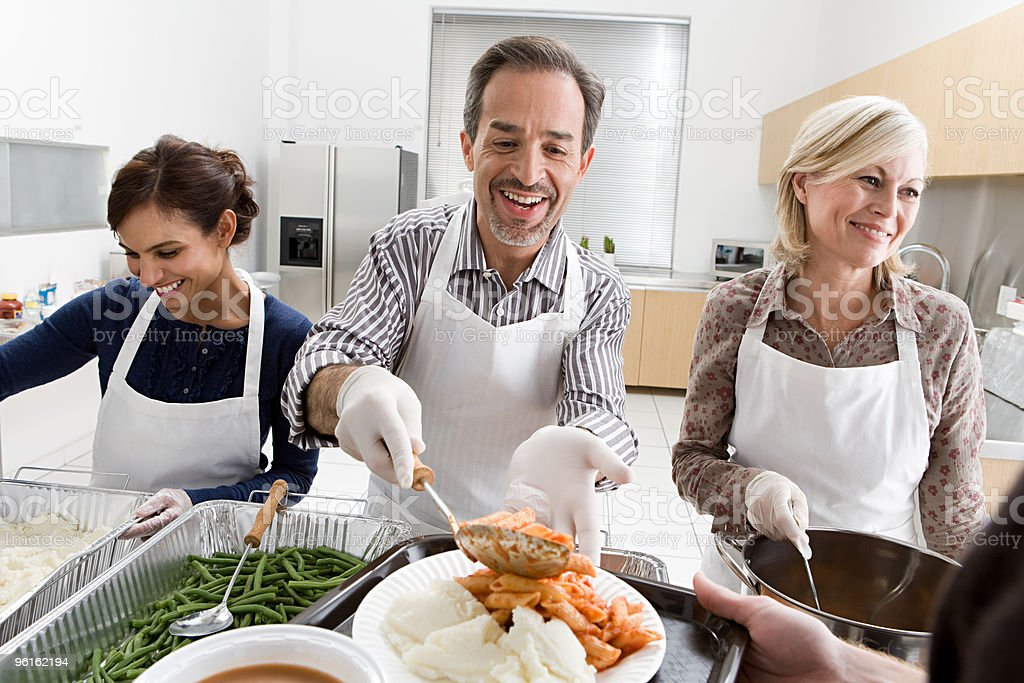 Exceptional People Volunteering At Soup Kitchen Stock Photo Good Looking