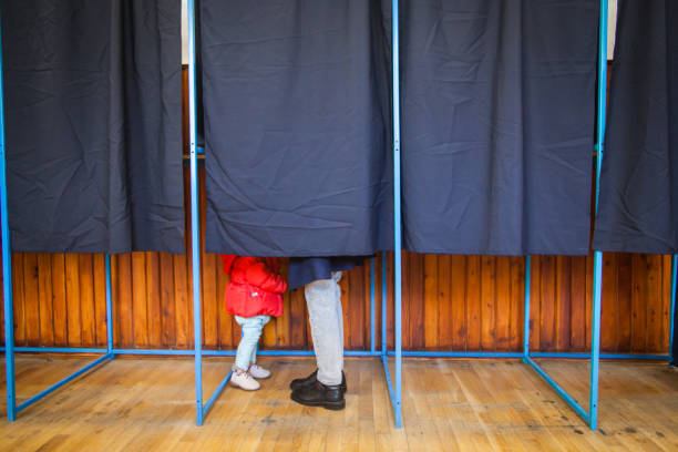 people vote in voting booth - polling place stock pictures, royalty-free photos & images