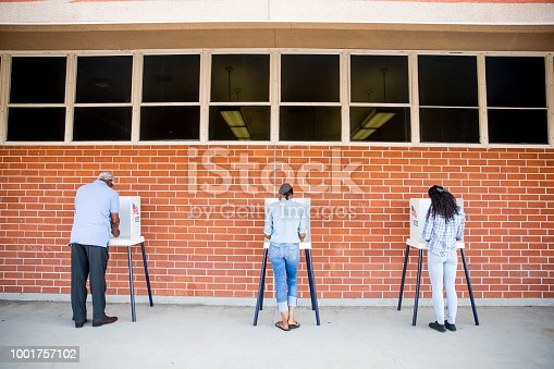 1001757174 istock photo People Voting in a Government Election 1001757102