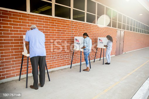 1001757174 istock photo People Voting in a Government Election 1001757148