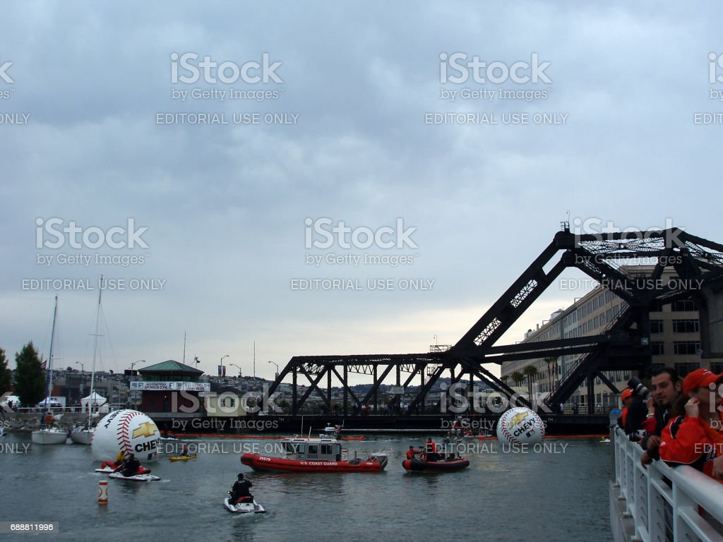 People wait along railing and in boats and jet-ski's in the water of McCovey Cove outside AT&T Park during the MLB All-Star Game stock photo