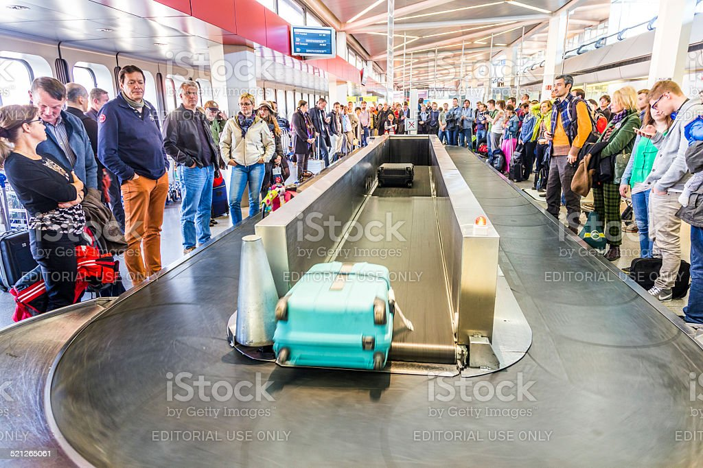 people wait at baggage belt  in  Tegel airport stock photo