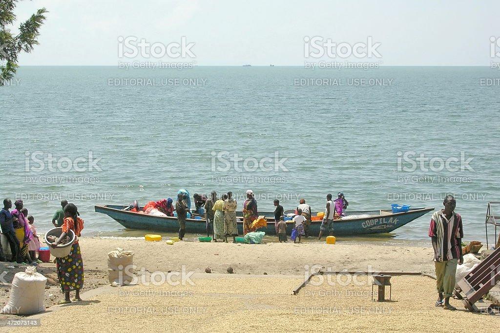 People wait for a new fish catch in Gisenyi, Rwanda. stock photo