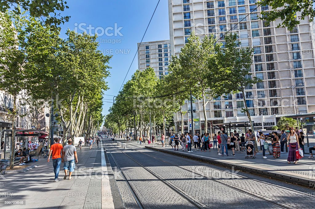 people wait for the streetcar in the town of Marseilles stock photo