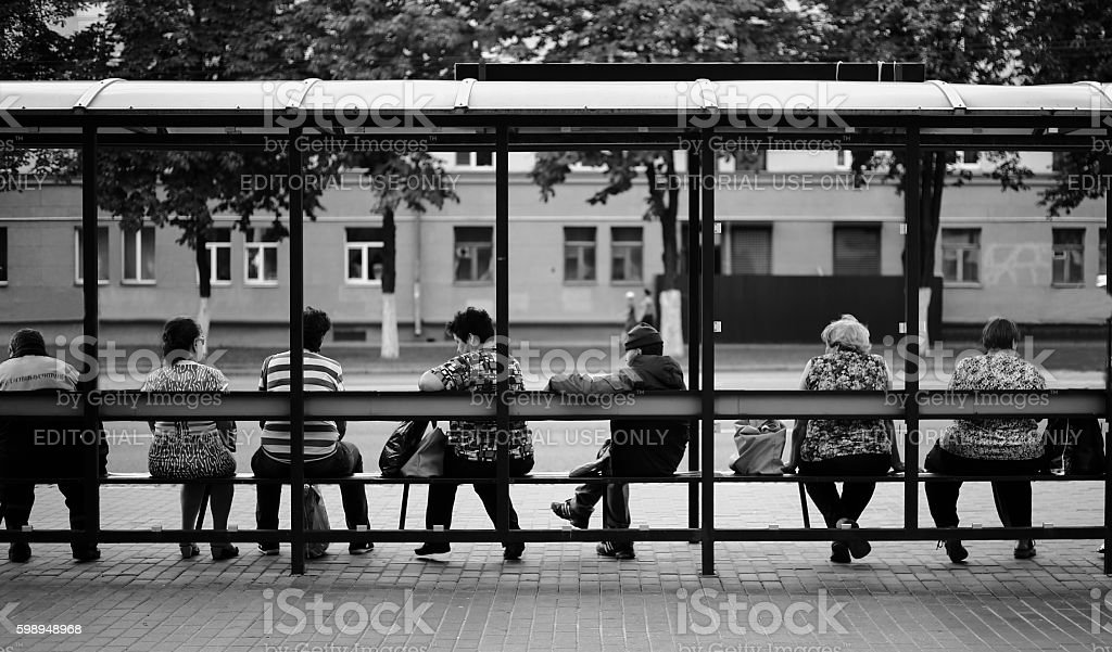 People waiting at the bus stop stock photo
