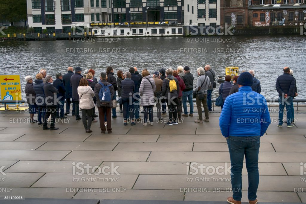 People waiting close to Spree in Berlin. royalty-free stock photo