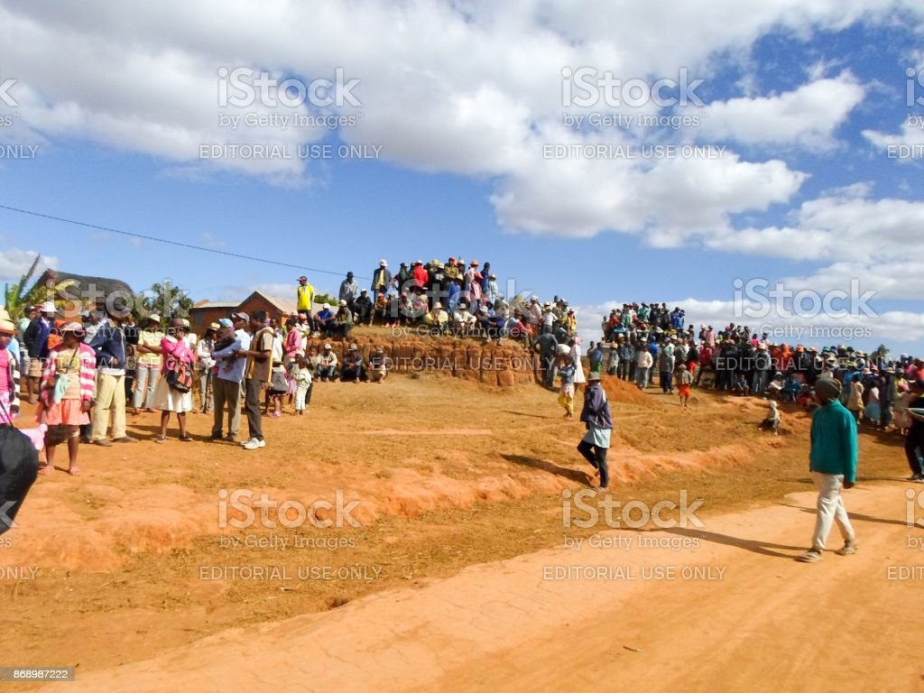 People waiting exhumation during the rite of 'famadihana' (turning of the dead) in the highlands of Madagascar stock photo