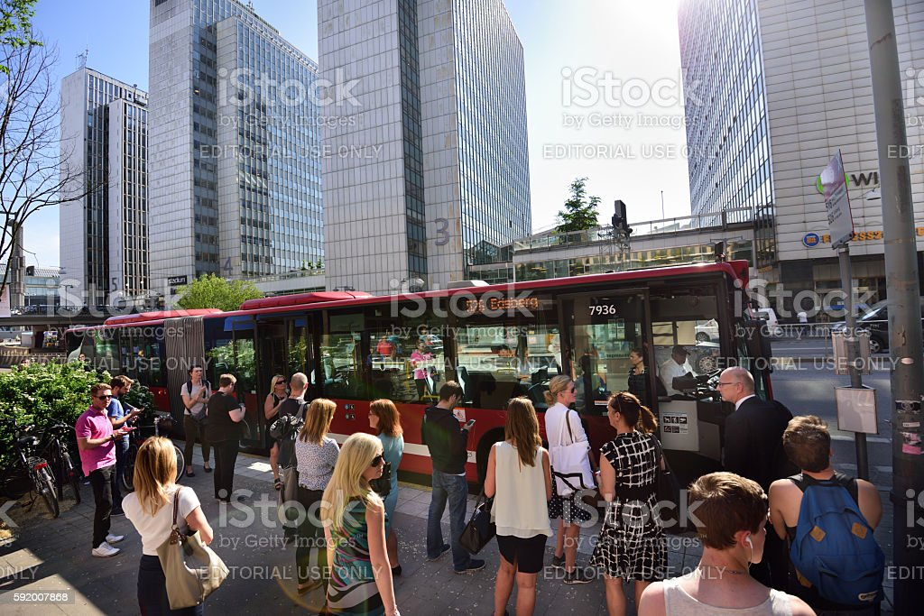 People waiting for bus at bus stop in Stockholm stock photo