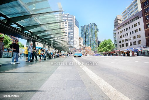 1060957508 istock photo People waiting for bus at bus terminal, motion blurred 636805564