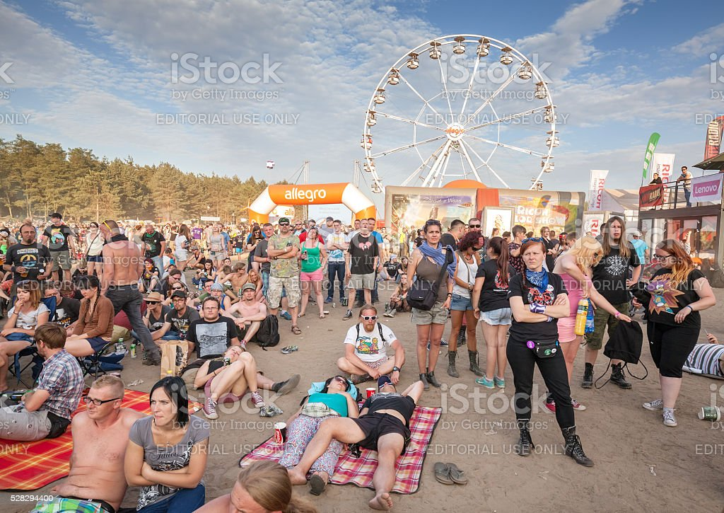 People waiting for concert in front of main stage. stock photo