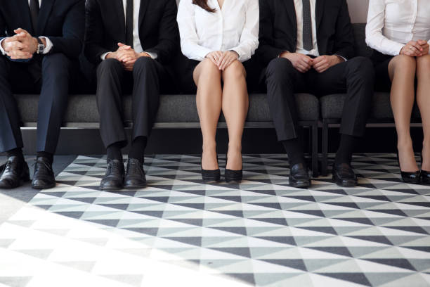 people waiting for job interview - job search stock photos and pictures