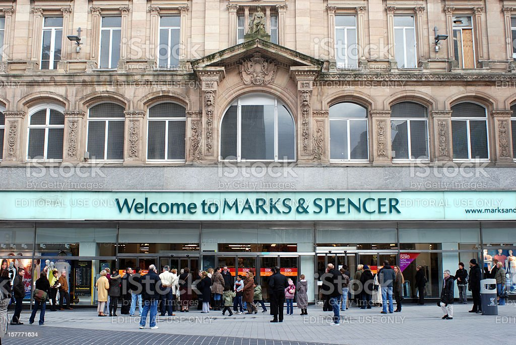 People waiting for Marks & Spencer shop to open stock photo