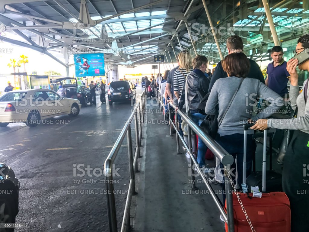 People  waiting for taxis at  Lisbon Portela Airport, Portugal stock photo