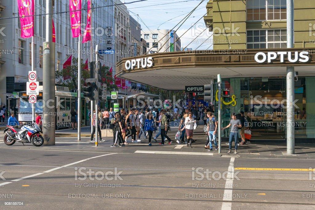 People waiting for traffic lights on corner Elizabeth and Bourke street stock photo