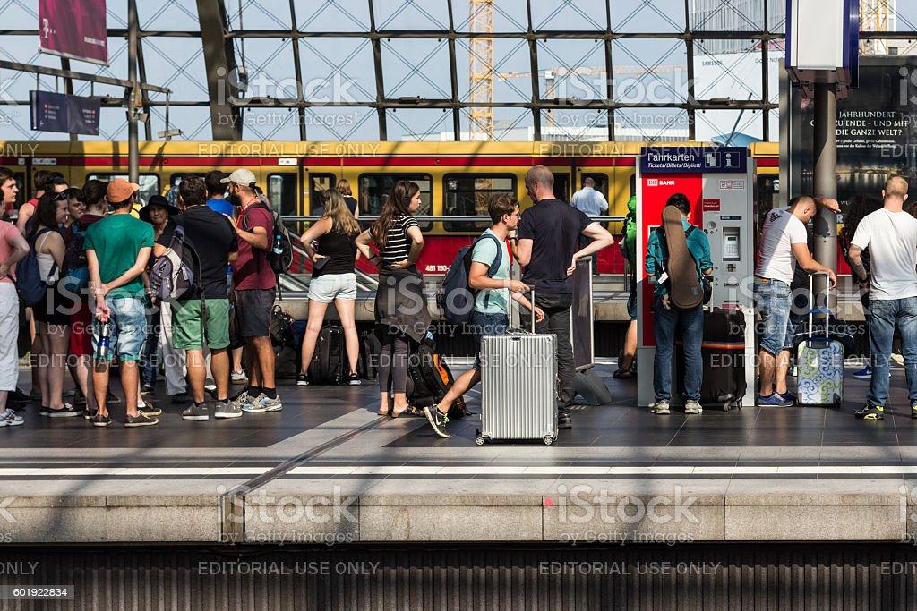 people waiting for train on plattform stock photo