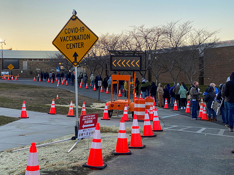 Gloucester, New Jersey, USA, 1-28-2021:Line of people waiting for vaccination covid treatment outside