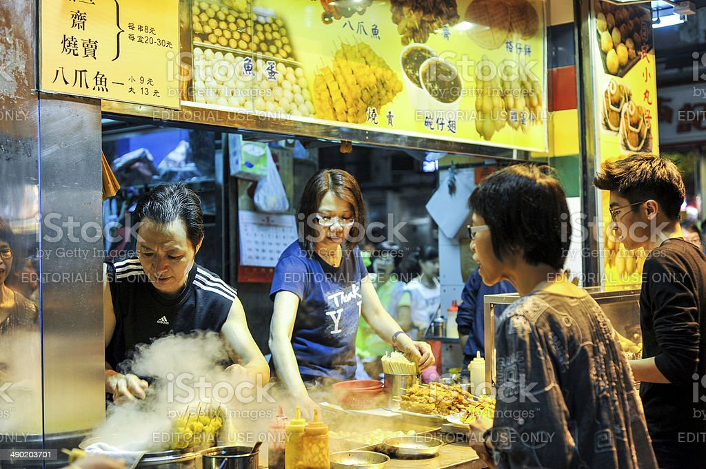 People waiting in a line for street food,Hong Kong stock photo