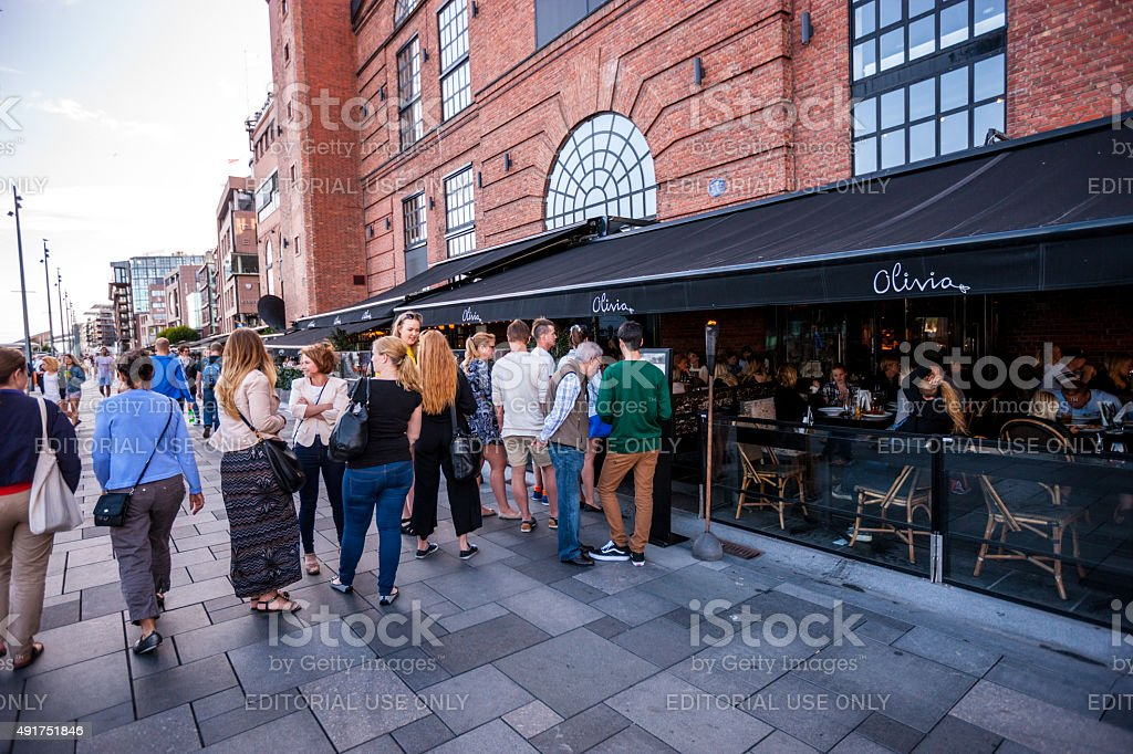 People waiting in line at the restaurant entrance stock photo