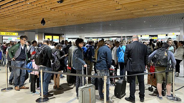 People waiting in line for check-in, Schipol Airpot stock photo