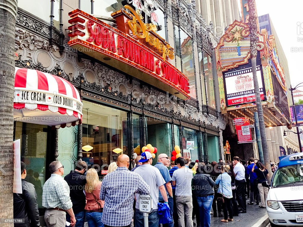 people waiting in line near el capitan theatre hollywood stock photo