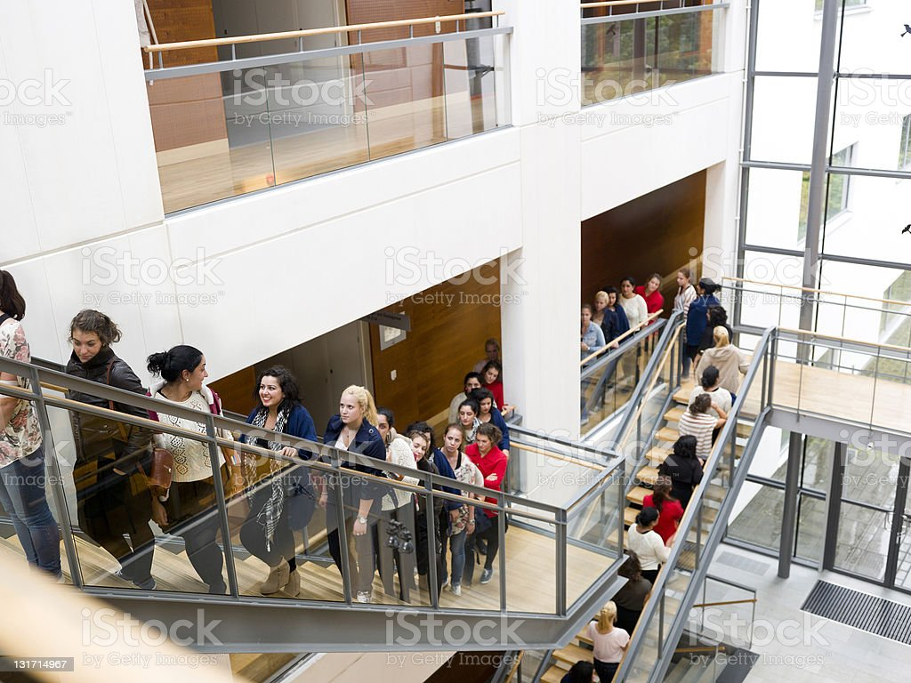 People waiting in line on stairs stock photo