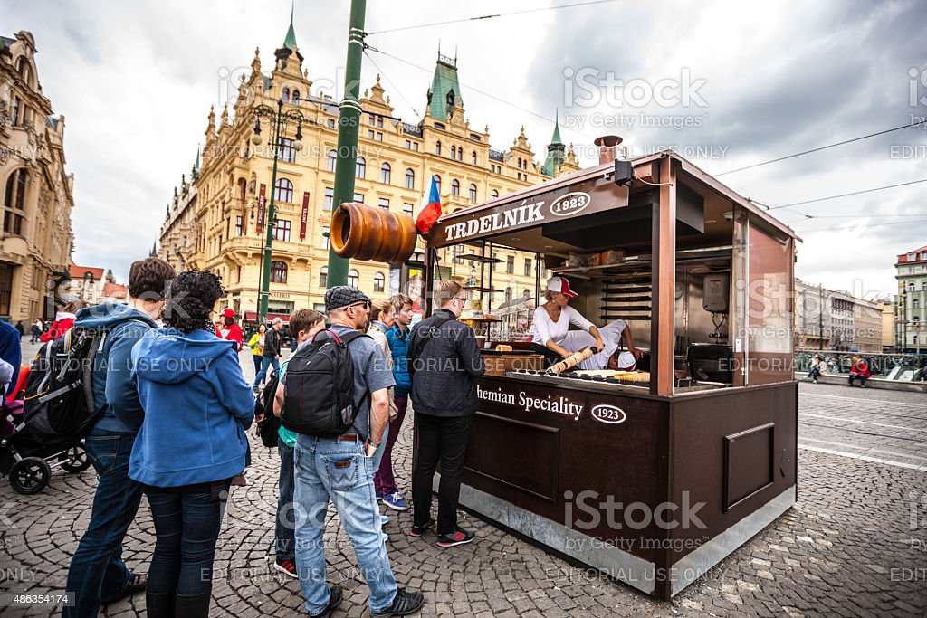 People waiting in line to buy famous Trdelnik, Prague stock photo
