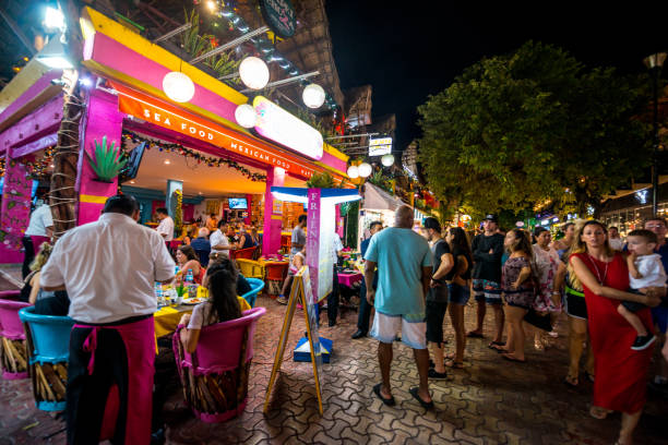 people waiting in line to enter restaurant on 5th avenue, playa del carmen, mexico - playa del carmen stock photos and pictures
