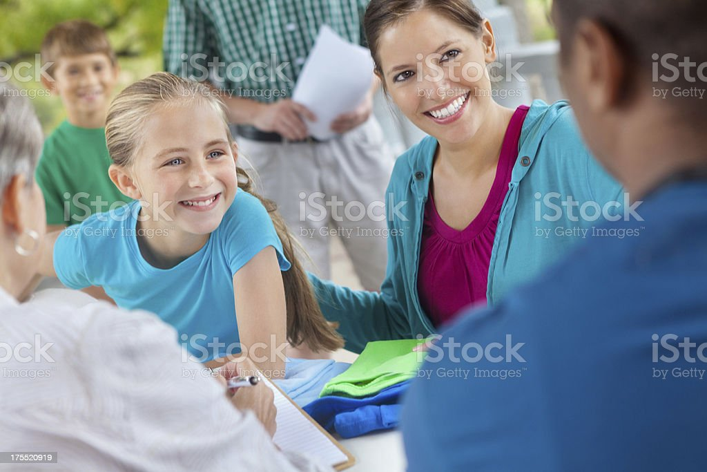 People waiting in line to sign up for sports team stock photo