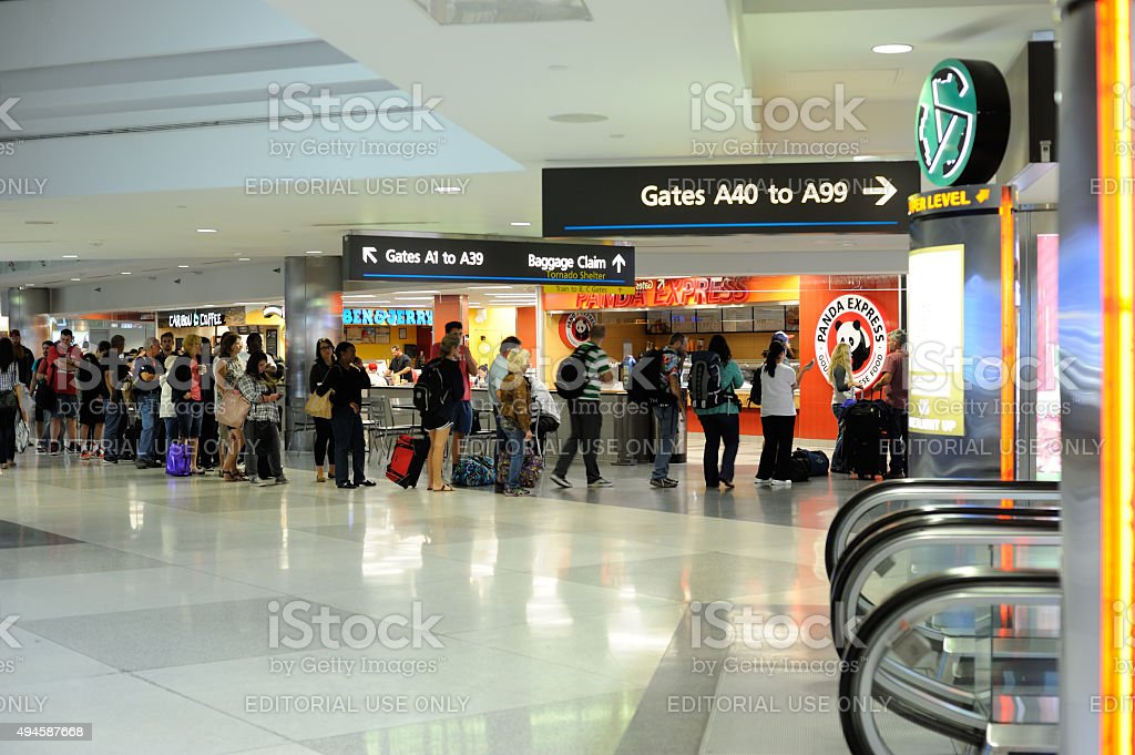 People Waiting to Buy Food at Denver International Airport stock photo