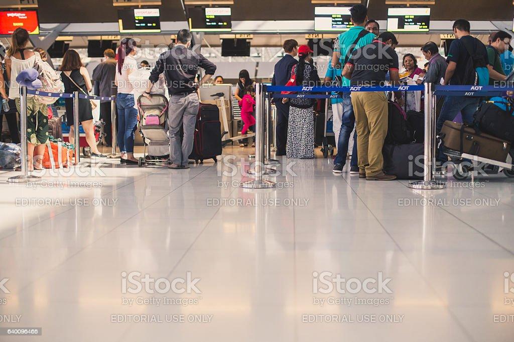 People waiting to check in at the Suvarnabhumi airport stock photo