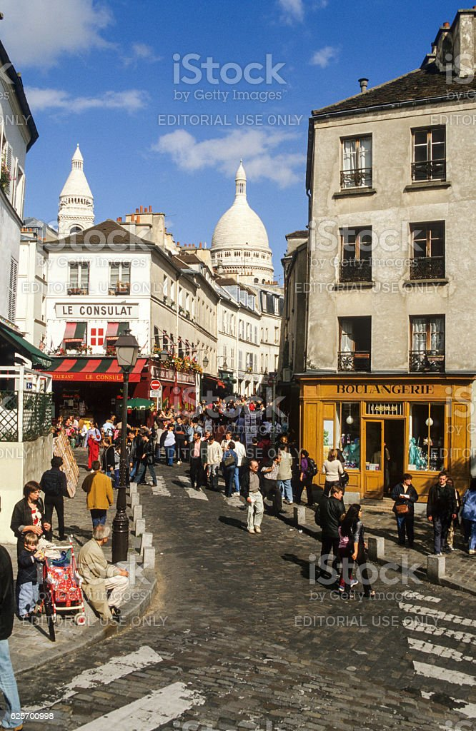 People waking at the neighborhood of Monmartre stock photo