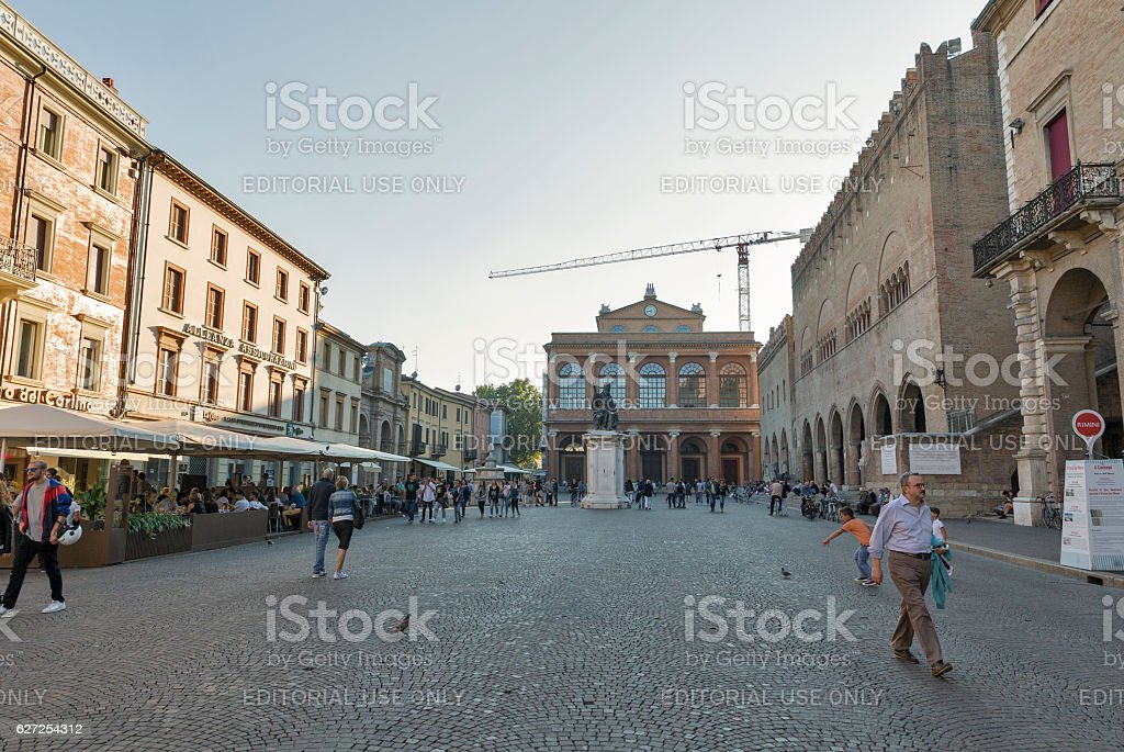 People walk along Piazza Cavour in Rimini, Italy. stock photo