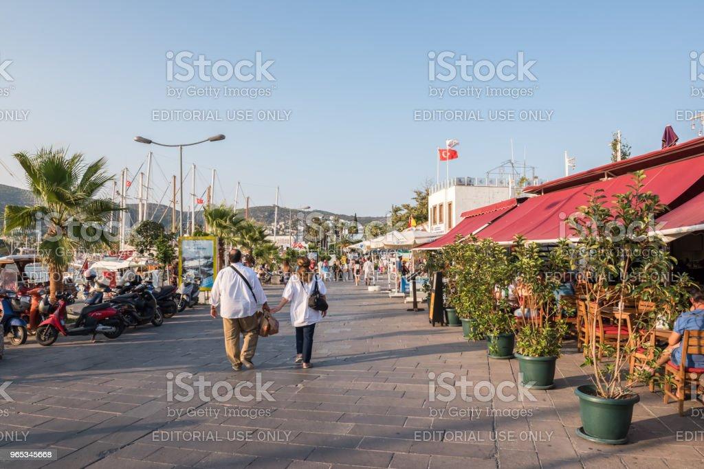 people walk along shore in Bodrum, Turkey zbiór zdjęć royalty-free
