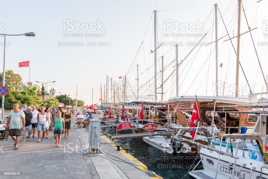people walk along shore in Bodrum, Turkey royalty-free stock photo
