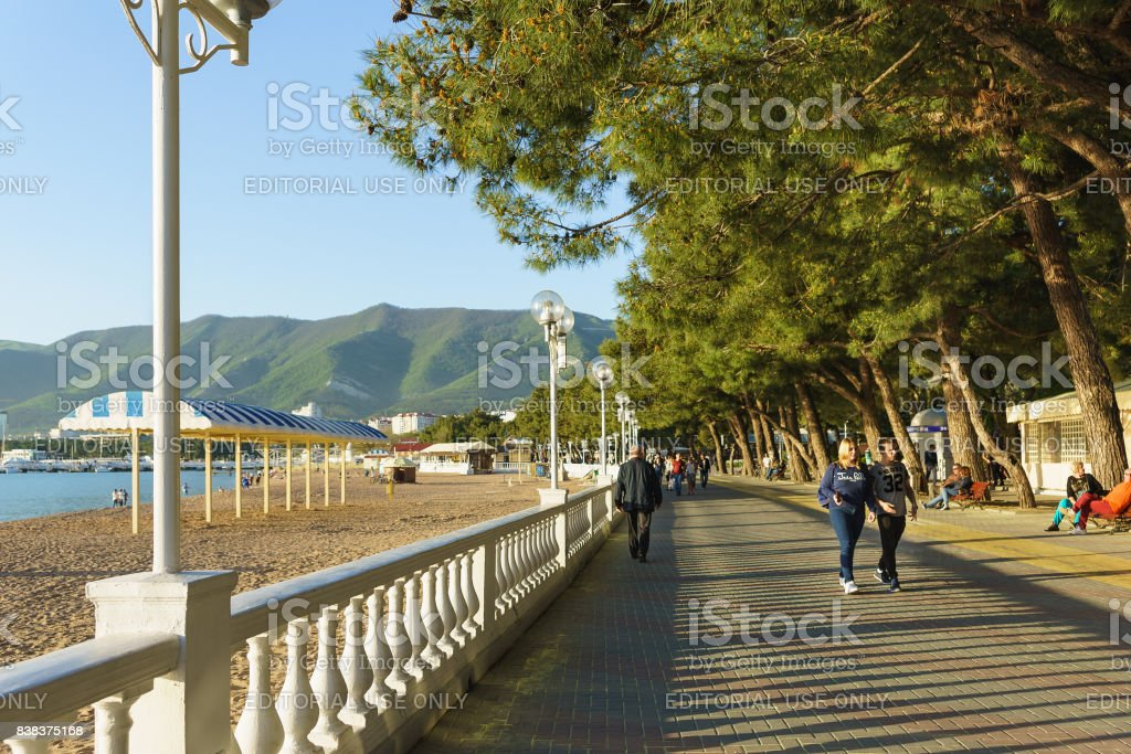 Gelendzhik Krasnodar Krai Russia April 292017 People Walk Along The Embankment Of Gelendzhik On The Background Of Mountains And Alleys Of Pine Trees Stock Photo Download Image Now Istock