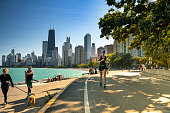 Chicago, Illinois, USA - September 25, 2018:  People walk and exercise along the Lakefront Trail on Lake Michigan and Lake Shore Drive in Chicago, Illinois USA.