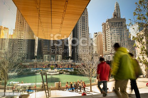Chicago, Illinois, USA - September 23, 2018:  Cars and people walk along the Magnificent Mile street on Michigan Avenue next to the DuSable bridge over the Chicago River in, Illinois, USA