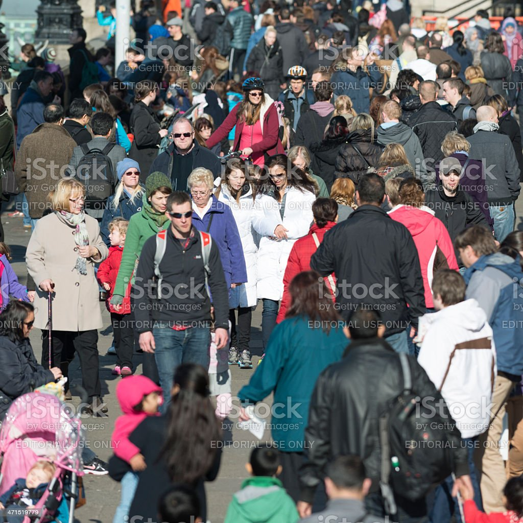 People walk along the South Bank in London royalty-free stock photo