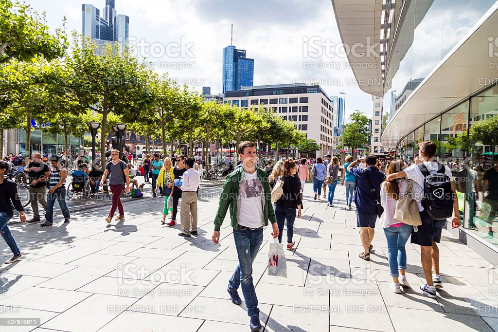 people walk along the Zeil in Frankfurt stock photo