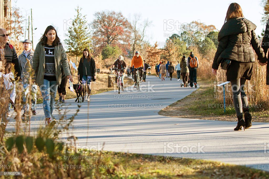 People Walk And Bike Along Atlanta Beltline Recreational Area stock photo