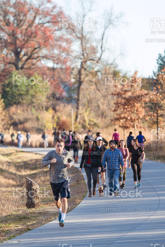 People Walk And Run In Urban Greenspace Along Atlanta Beltline stock photo