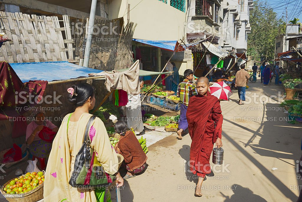 People walk by the local market in Bandarban, Bangladesh. stock photo
